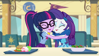 Twilight Sparkle and Rarity hugging EGDS12a