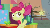 Apple Bloom shaking a gift box S5E20