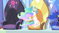 Celestia gesturing to Twilight's seat S4E24.png