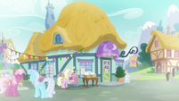 Exterior view of Ponyville store in flashback S9E19