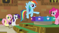 Rainbow points at button switch mechanism S7E2.png