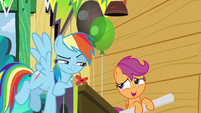 Scootaloo rolling up her Washouts poster S8E20
