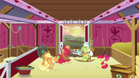 Apple family laughing together in the barn S6E23