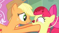 Applejack holding Apple Bloom's face S4E17