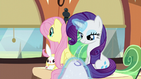 Fluttershy window-gazes while Rarity sews S6E1