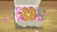 Heart-shaped apple pie inside the package S8E10