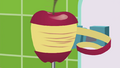 Apple in an automatic apple peeler SS9.png