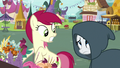 Rarity appears before Rose in a cloak S7E19.png