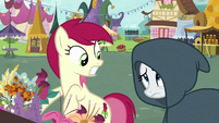 Rarity appears before Rose in a cloak S7E19