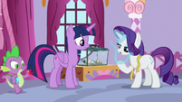 Rarity holding a glowing thread of web S9E26