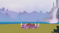 Twilight and Spike with the Cutie Map in the middle of a field S5E25