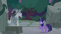 Twilight walks up to Star Swirl's holographic image S7E25