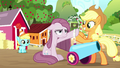 AJ wraps cannon pullcord around Pinkie's hoof S8E18.png