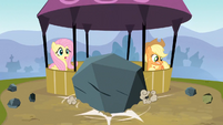 A boulder lands in front of Fluttershy and Applejack S3E09