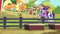 Applejack luring pigs with corn S6E10.png