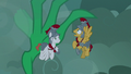 Green dragon stretches claw at white Legion cadet S7E16.png