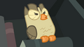 Owlowiscious hooting while standing on a book S4E23.png