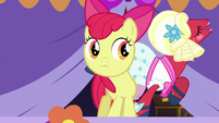 Apple Bloom looks at Orchard Blossom while singing S5E17