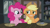 Applejack smiling nervously at Pinkie again S5E20