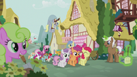 Crusaders lead a parade through Ponyville S5E18