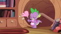 Spike cleaning the library S4E03.png