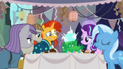 Starlight and friends gathered around the cake S9E11