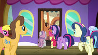 Twilight, CMC, and ponies board the train S8E6