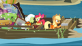 Apple Bloom and Granny Smith playing a game while Applejack controls the raft S4E09.png