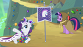 Princess Platinum laying in front of the unicorn flag S2E11.png