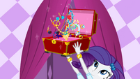 Rarity throws accessories in the air EG