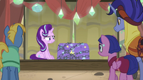 Starlight sitting next to Trixie's stage trunk S8E19
