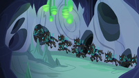 Changeling swarm flying down center tunnel S6E26