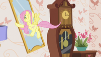 Fluttershy picking up a wall mirror S7E12