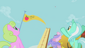 Ponies cheer after Applejack's bucking contest turn S01E13.png