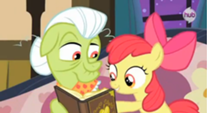 207px-Applebloom pointing to a picture in the album S3E8