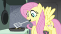 Fluttershy flipping burgers S4E22.png