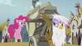Gilda sees Pinkie hopping beside the carriage S5E8.png