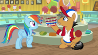 Quibble Pants picking up a basket S9E6