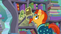 Sunburst levitates the books into the bookshelves S6E2