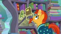 Sunburst levitates the books into the bookshelves S6E2