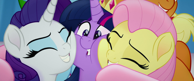 File:Twilight Sparkle in a tight group hug MLPTM.png