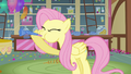 Fluttershy blowing knotted party horn S03E13.png