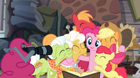 Pinkie about to take a picture with her tail S4E09