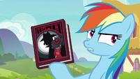 Rainbow Dash holding Shadow Spade book S8E17