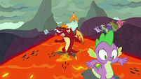 Spike and Garble surf down the lava slope S7E25