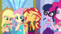Applejack, Fluttershy, and Sunset eating puffcakes EGDS11.png