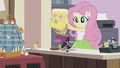 Fluttershy emptying the contents of her bag EG2.png