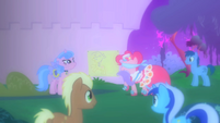 Pinkie Pie playing with ponies at the Gala S1E26