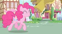 Pinkie trotting towards Twilight and Spike S1E01