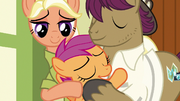 Scootaloo hugging her parents S9E12